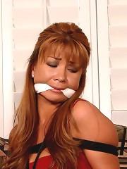 Hot milf tied up and gagged in..